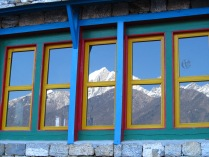 Himalaya reflected in window