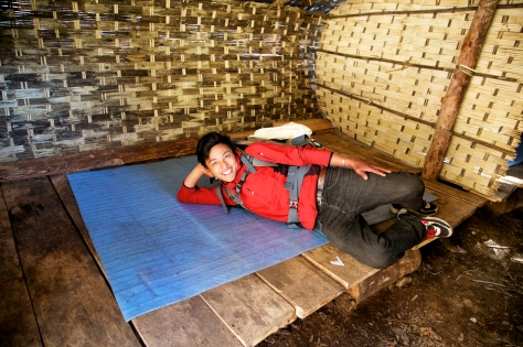 """Ang Rita shows off the sleeping area we had at the spot lovingly named by us as """"the Tick Farm"""", where Glen found a large tick trying to burrow into his back."""
