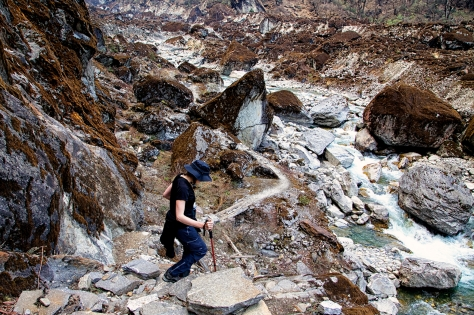 Christen picks her way through the boulders as she follows the trail along the river gorge.
