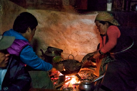 Tsongba helps Karma's mother, Kima, prepare our evening meal in her home.
