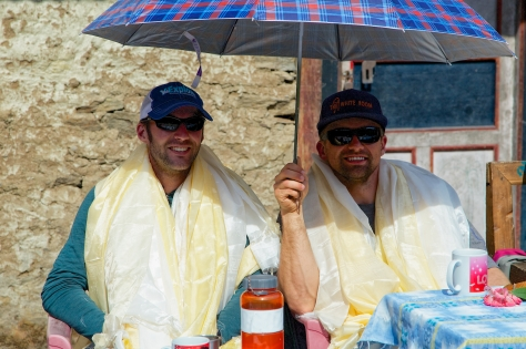 Underneath their scarves, Glen and Matt enjoy a little shade from Glen's trusty parasol. Photo Credit: Christen Babb