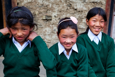 When you live several days of strenuous hiking from the nearest larger town, it is hard to find school uniforms. The gracious gift from Karma's Japanese friend brought smiles to the faces of the parents and children alike. Photo Credit: Christen Babb