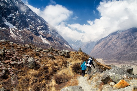 Christen and Pasang gradually make their way down towards Khote in the fine weather of the morning.