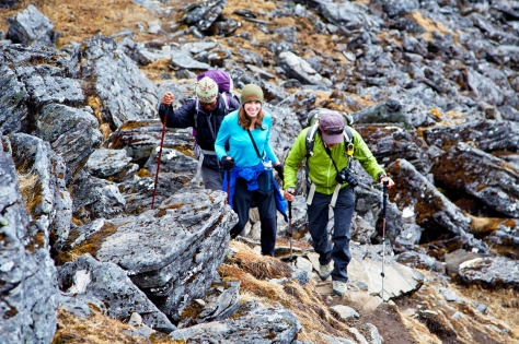 Pasang, Christen, and Karma enthusiastically hike upwards.