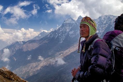 Pasang takes a break on the descent towards Lukla.