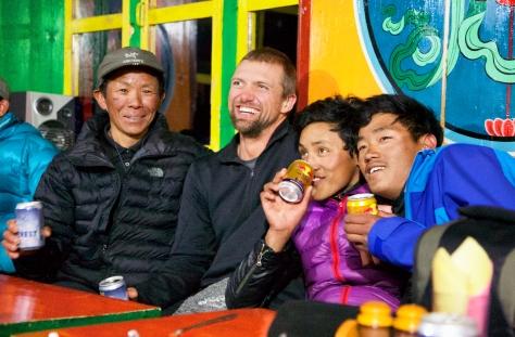 Kami, Matt, Ang Rita, and Dawa loosen up with Everest Beer and Red Bull.