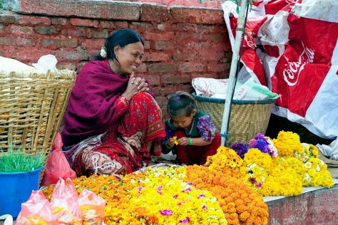 A mother and her daughter sell flowers in the Thamel Neighborhood of Kathmandu. © Luke Mislinski